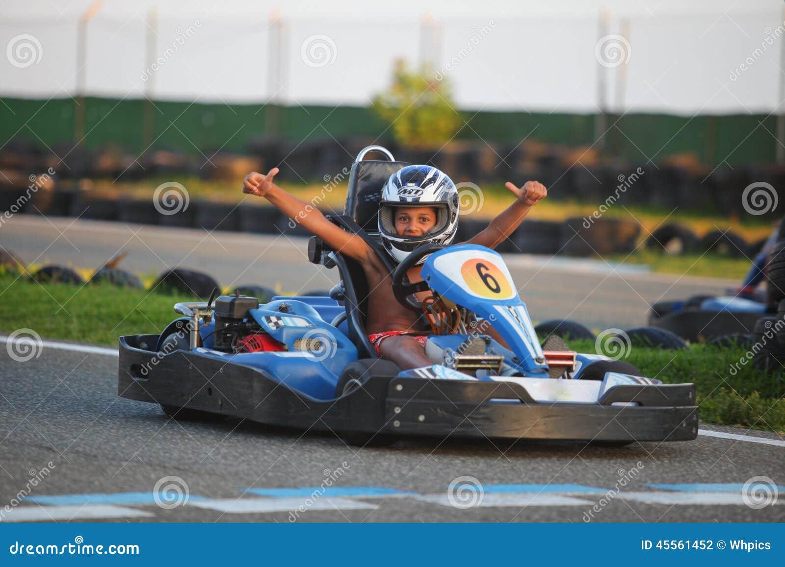 People Having Fun On A Go Cart Summer Season Editorial