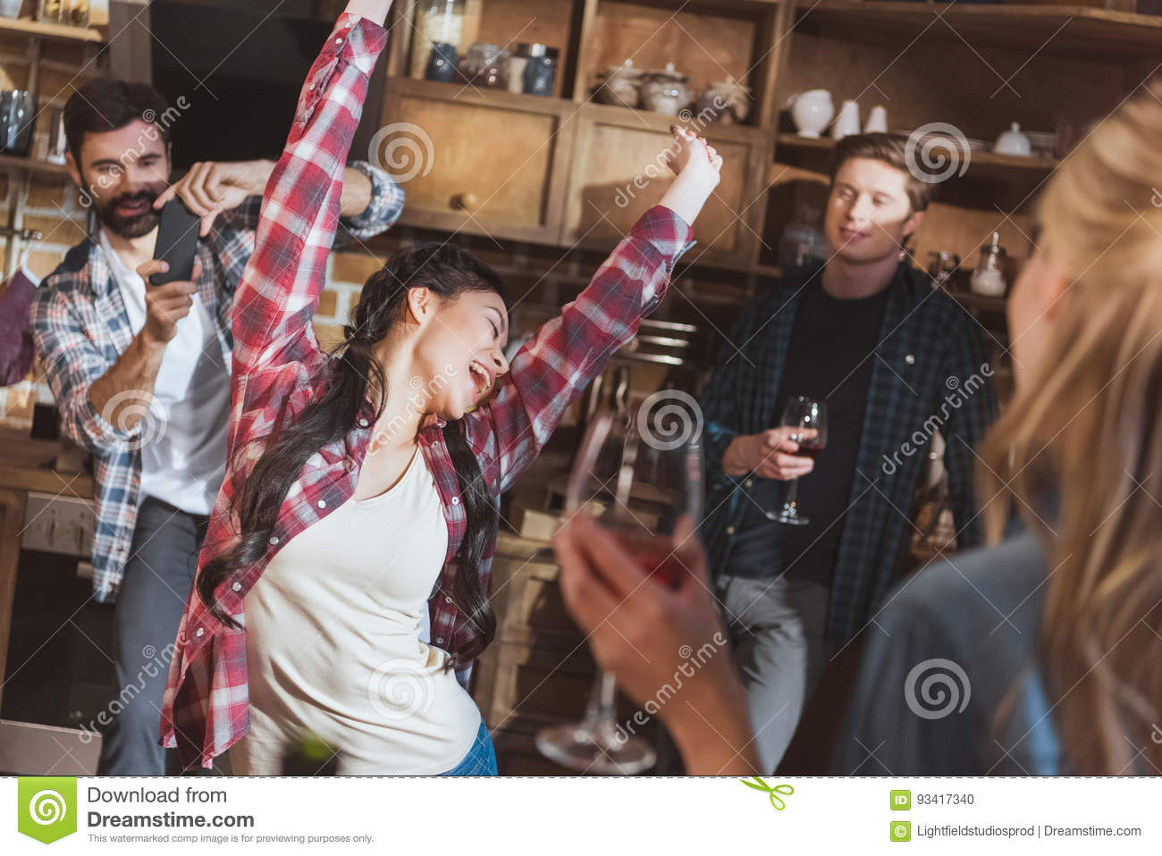 People having fun at home party