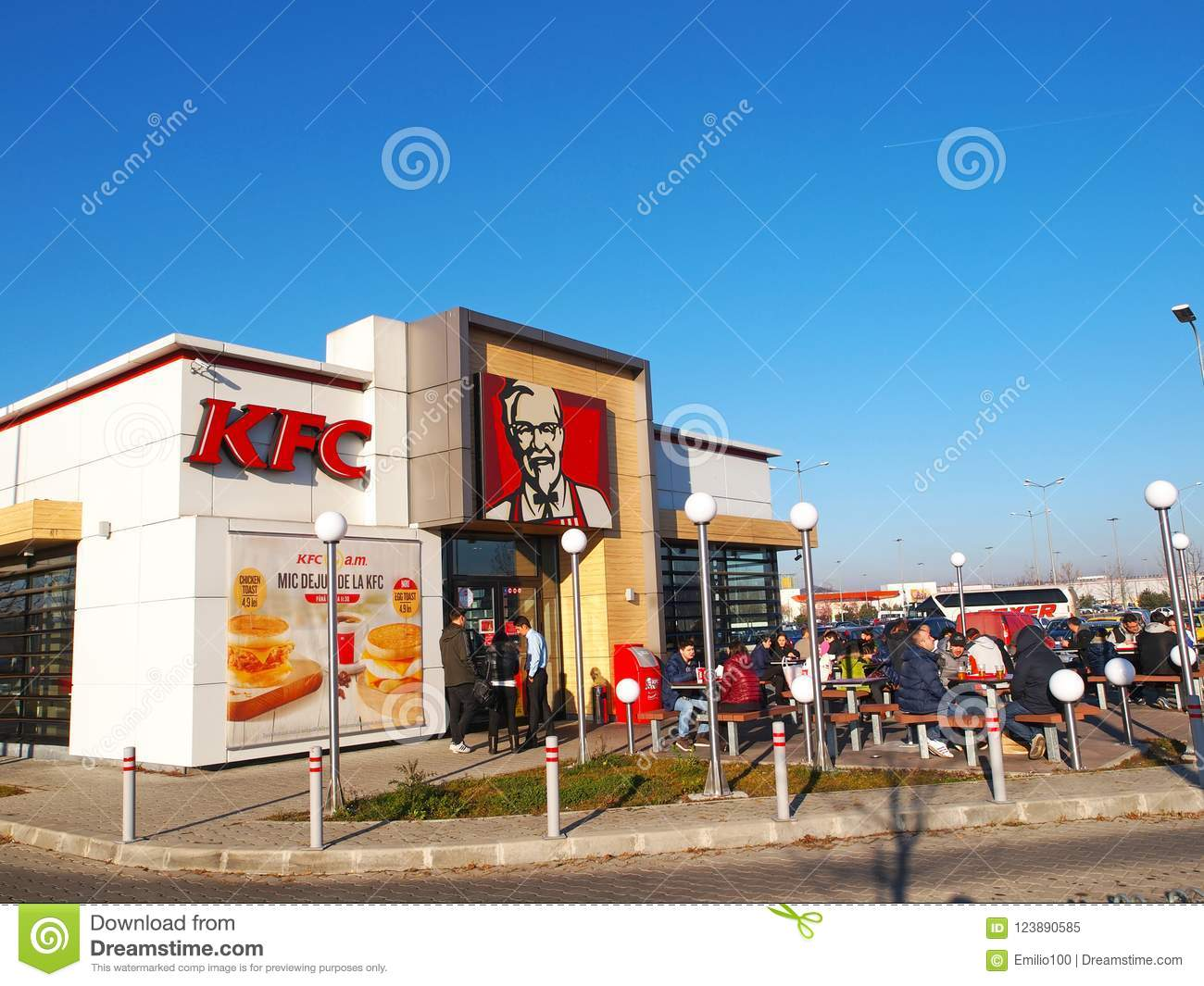 People Having Luch At Kentucky Fried Chicken Restaurant In