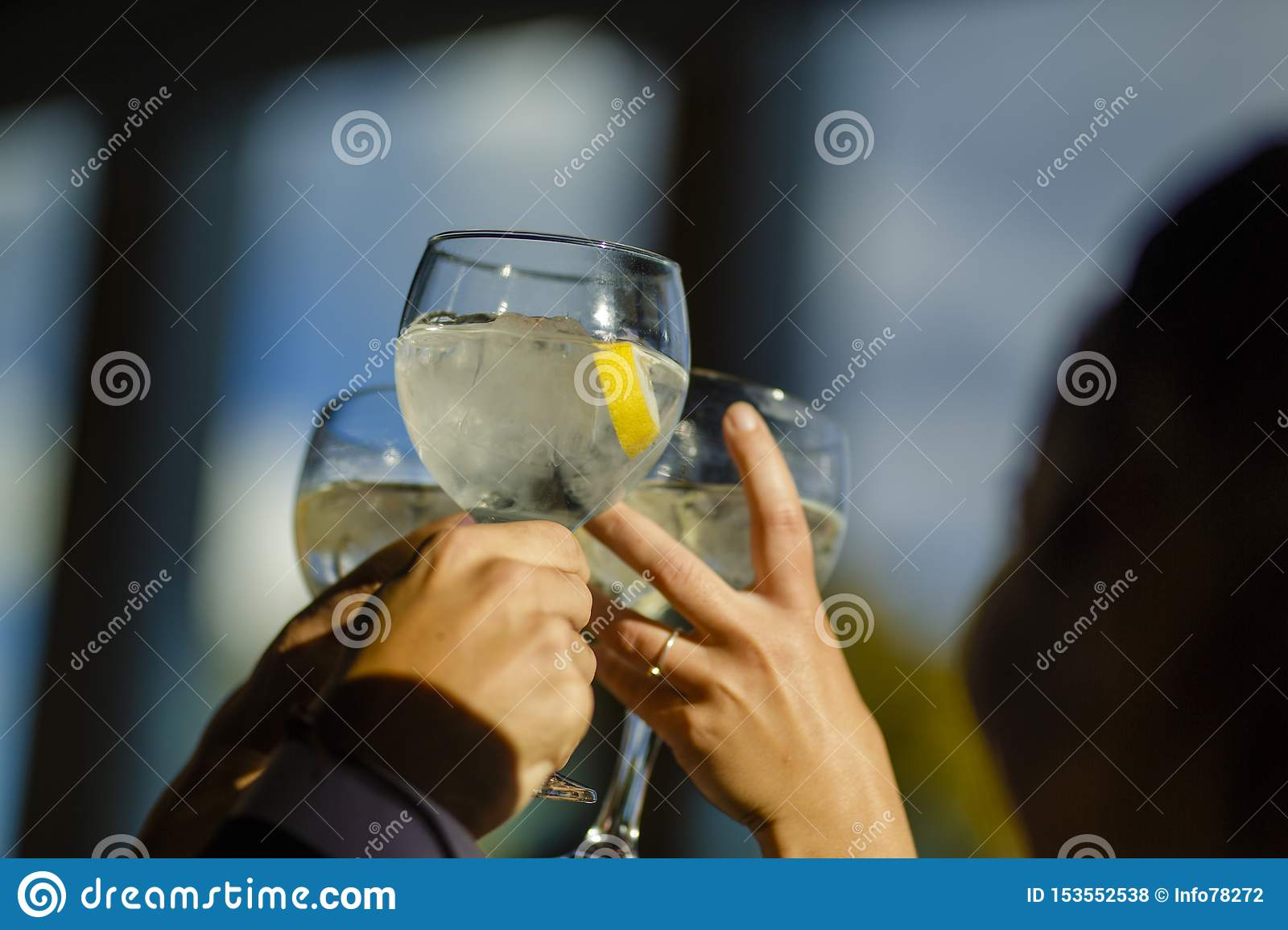 People hold toasting with glasses, friends celebrating and toasting