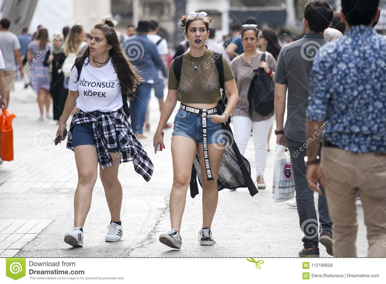 People At Istiklal. Girls Student In Shorts Walking Down The Street  Editorial Photo - Image of scarf, modern: 112189656