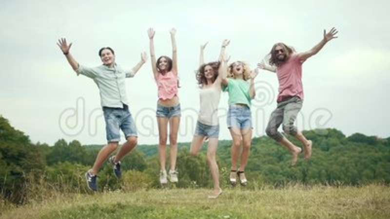 53bdafc91c441 People Jumping Outdoors. Group Of Friends Having Fun In Nature Stock ...