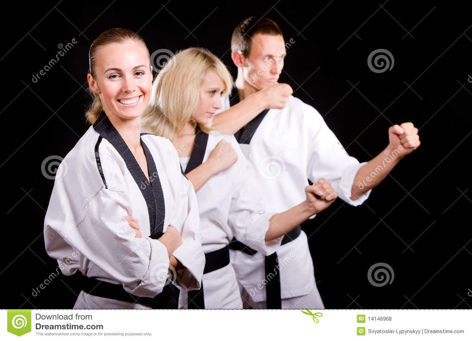 People in kimono make martial arts exercise