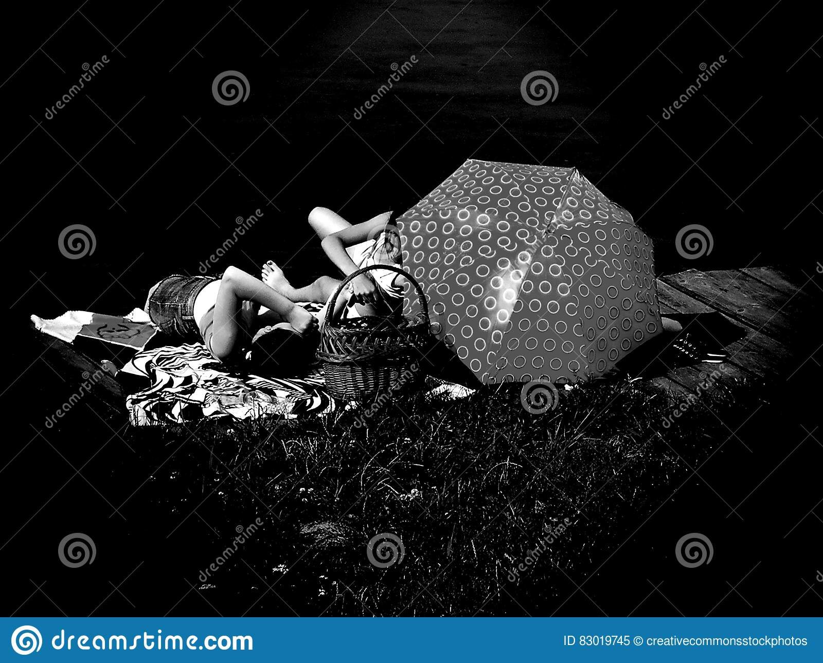 Download People Laying On Blanket Grayscale Photo Stock Image - Image of black, dark: 83019745