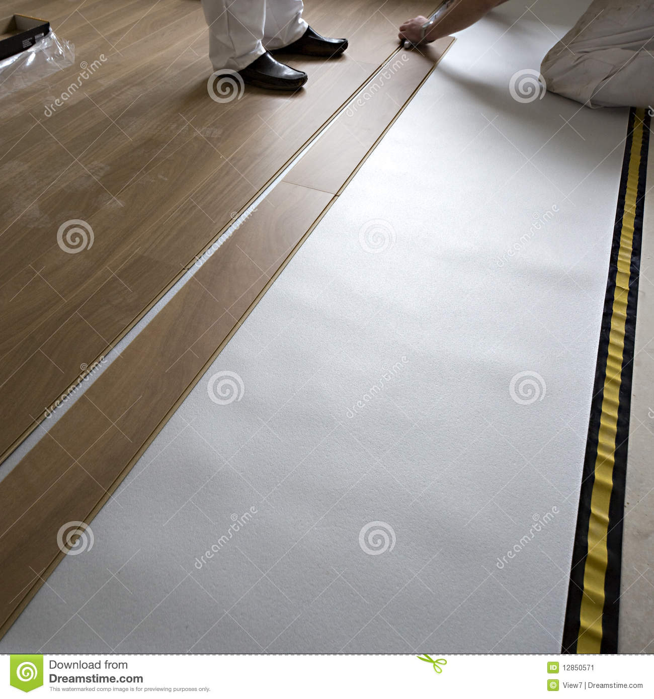 People laying wooden floor stock image image 12850571 for Floor someone