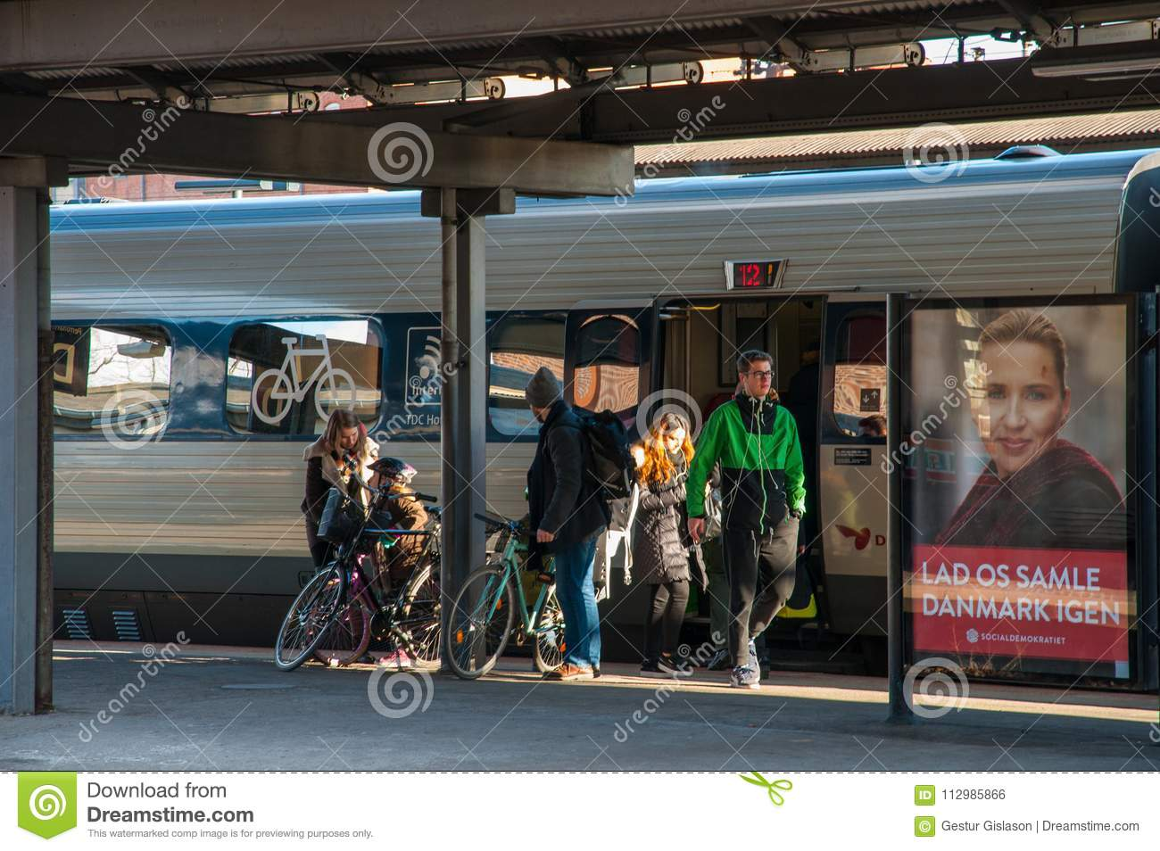 People leaving the train at Roskilde train station in Denmark
