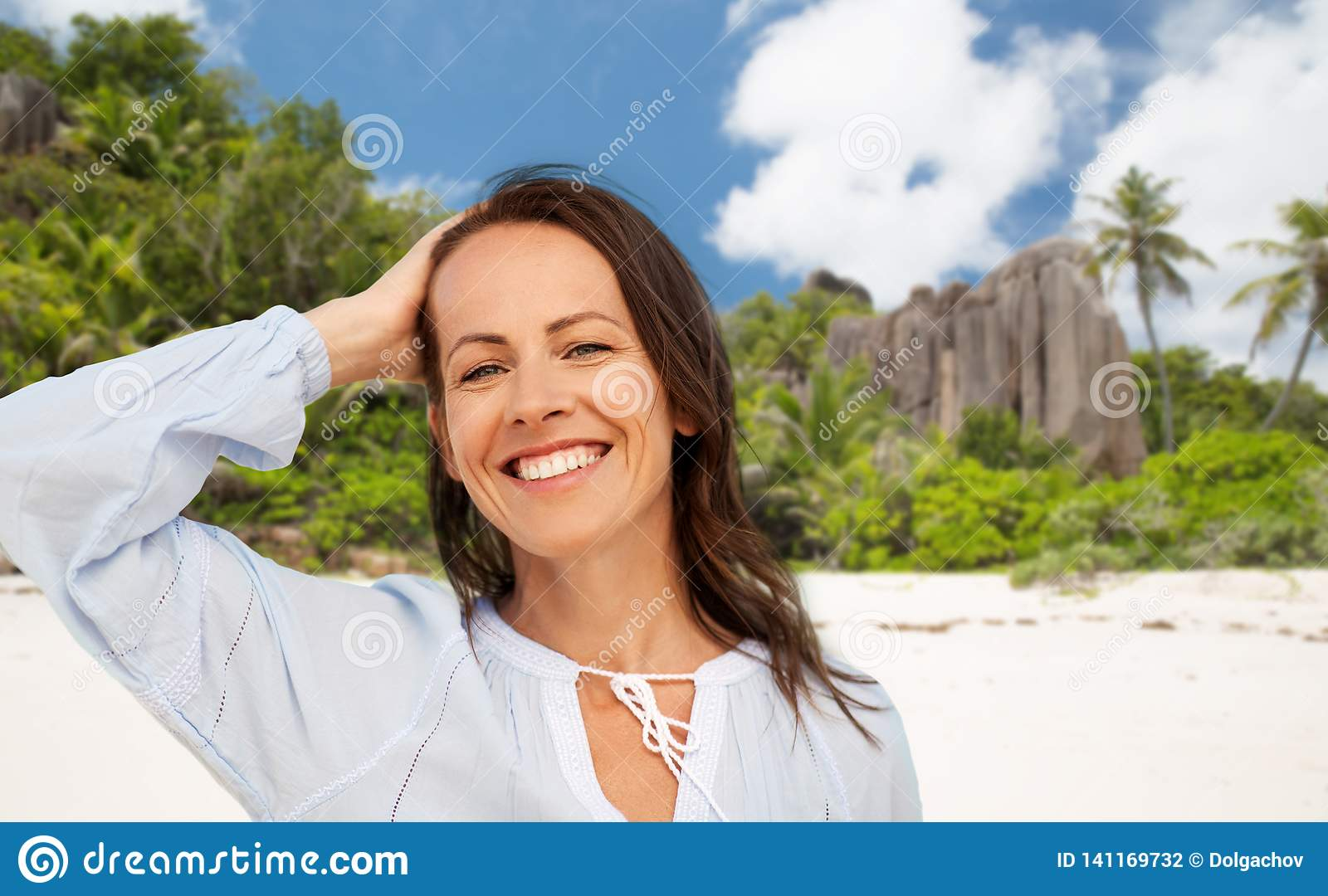 Happy smiling woman on summer beach