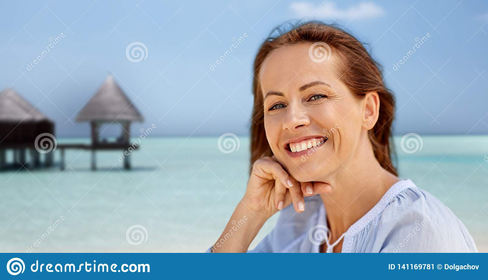 Portrait of happy smiling woman on summer beach