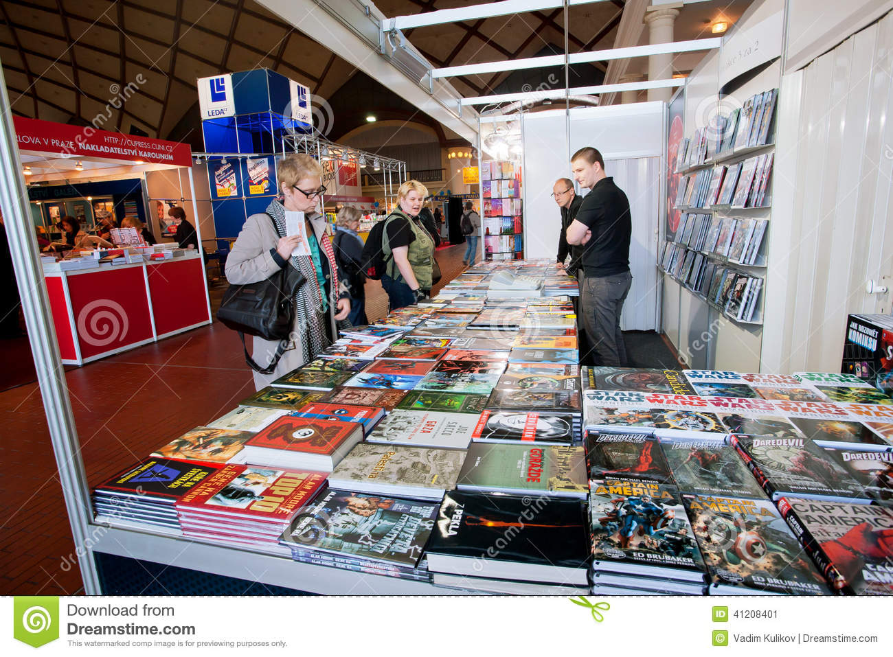 People look at comic books and graphic novels