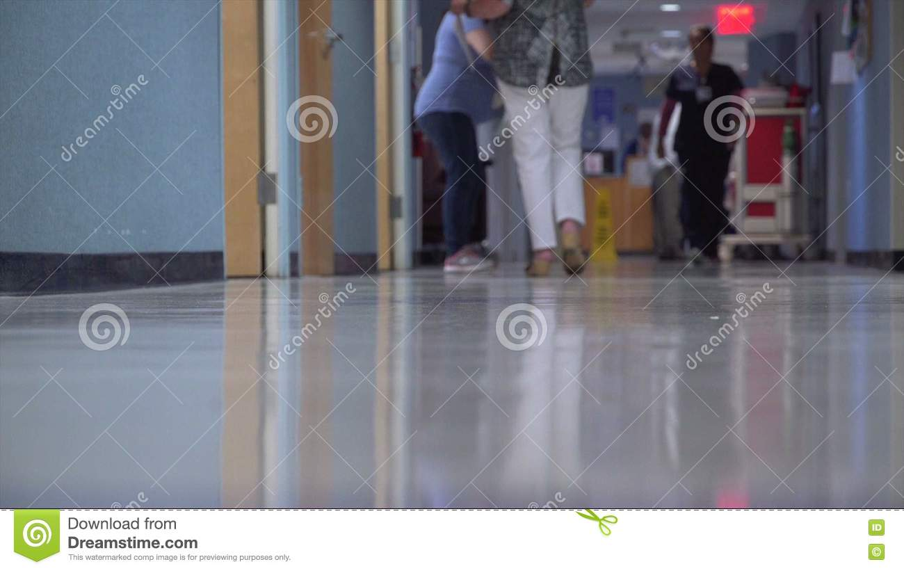 People Moving Around In A Busy Hospital Hallway Stock Footage
