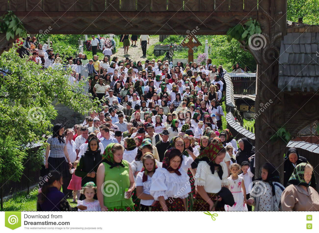 People in traditional national costume - landmark attraction in Maramures, Romania