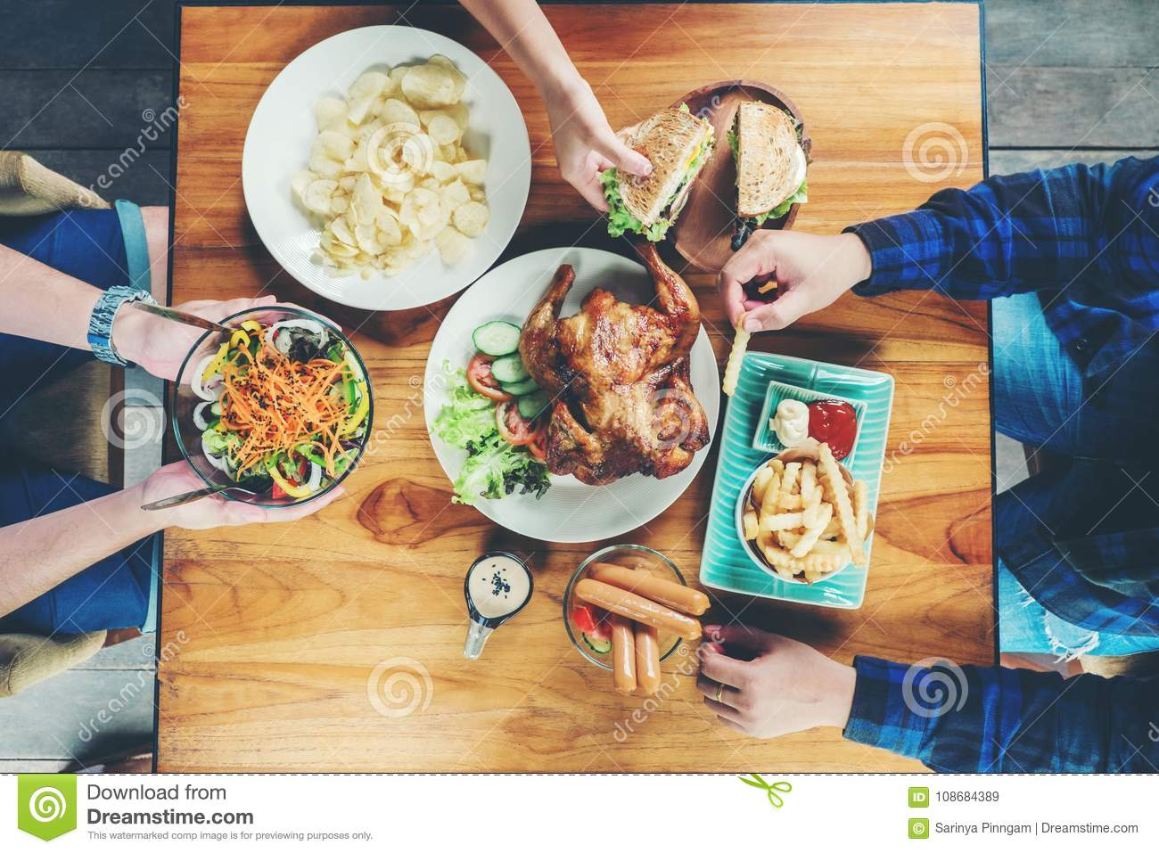 People Party and eating grilled chicken are happy enjoying in ho