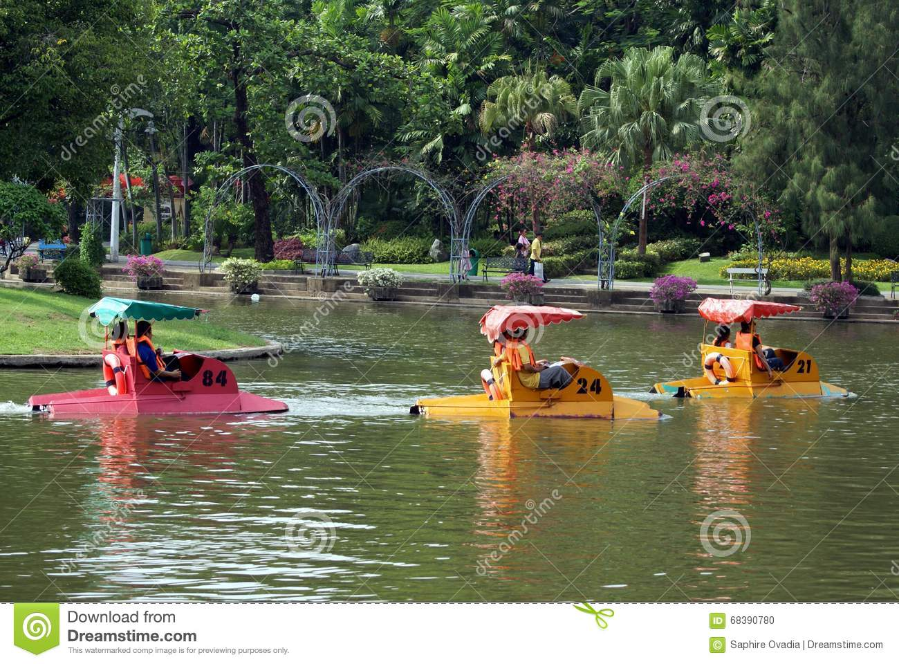 People pedalling boats on a lake in Dusit Zoo, Bangkok, Thailand