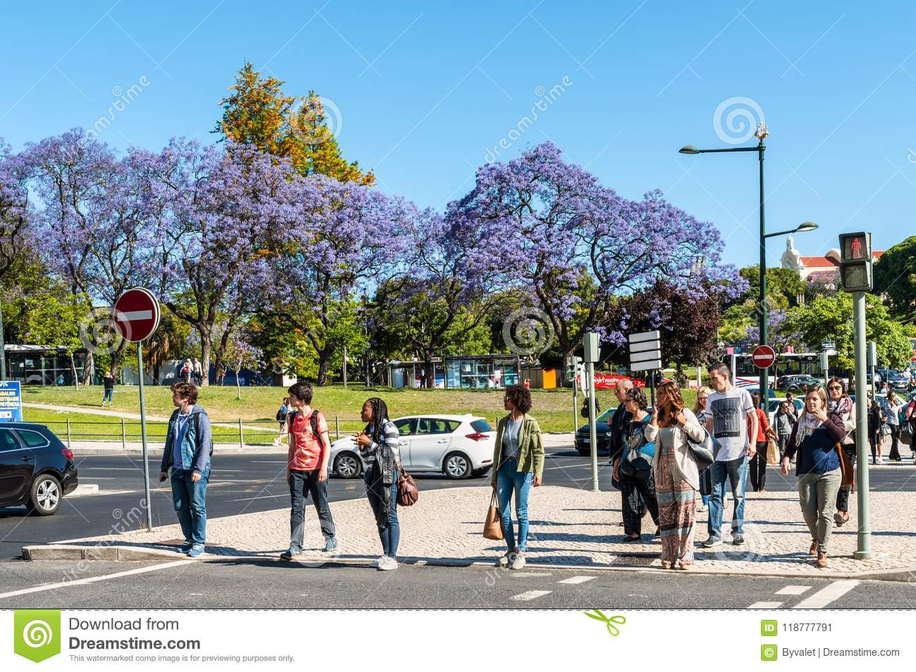 People on the pedestrian crossing in Lisbon, Portugal