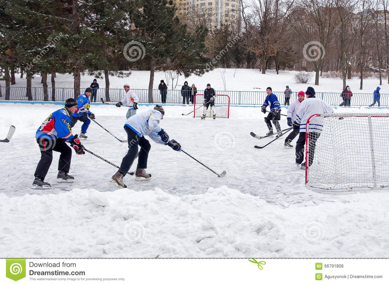 People Playing Amateur Hockey In The City Ice Skating Rink