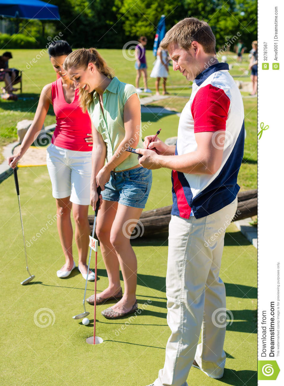People playing miniature golf outdoors