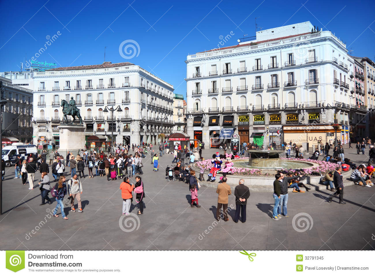 People at puerta del sol near monument editorial image for Puerta del sol 9 madrid