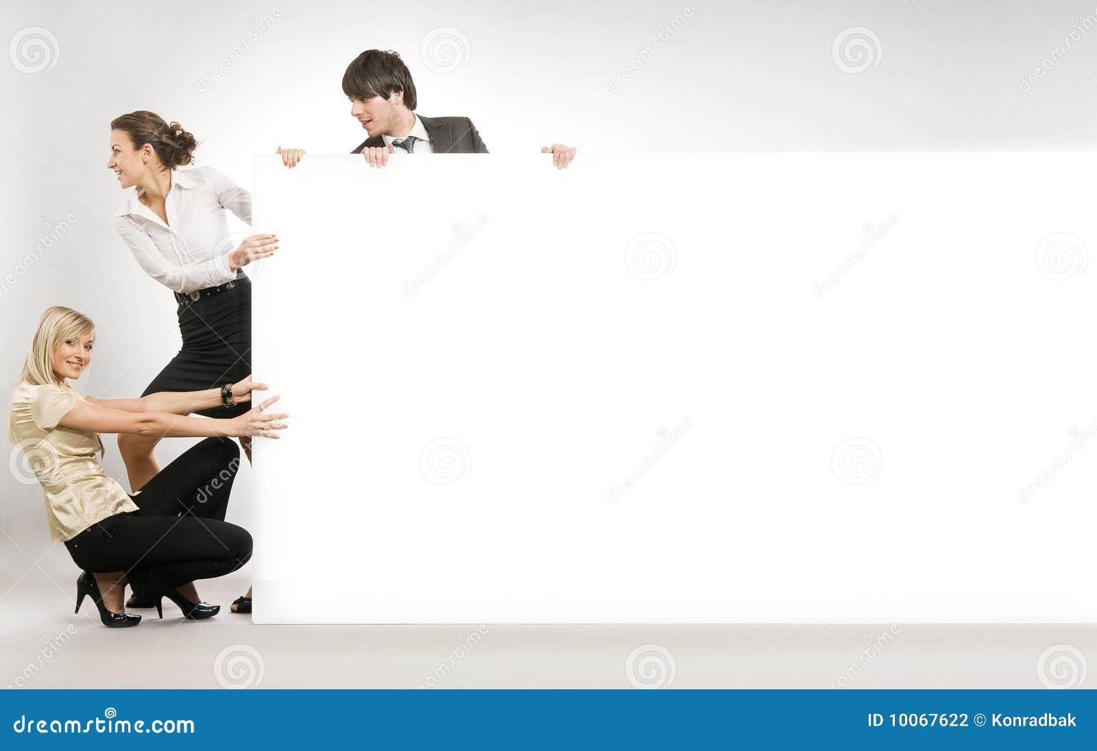 People pulling big white board,