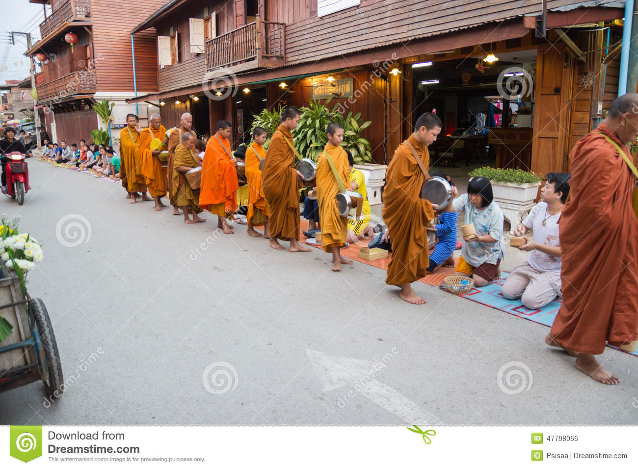 people put food offerings in a buddhist monk s alms bowl for goo