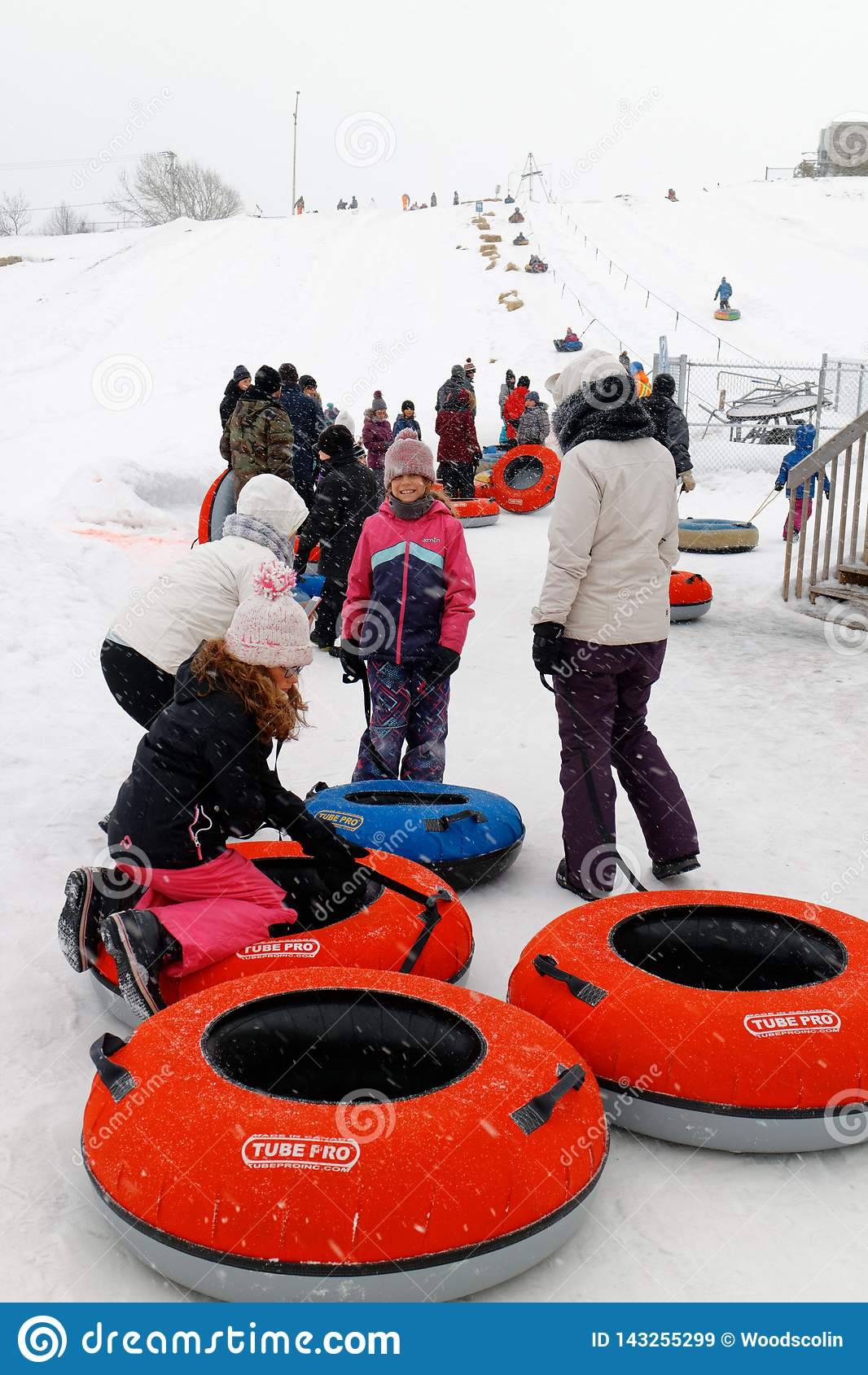 People queueing to go sliding in Rimouski, Quebec