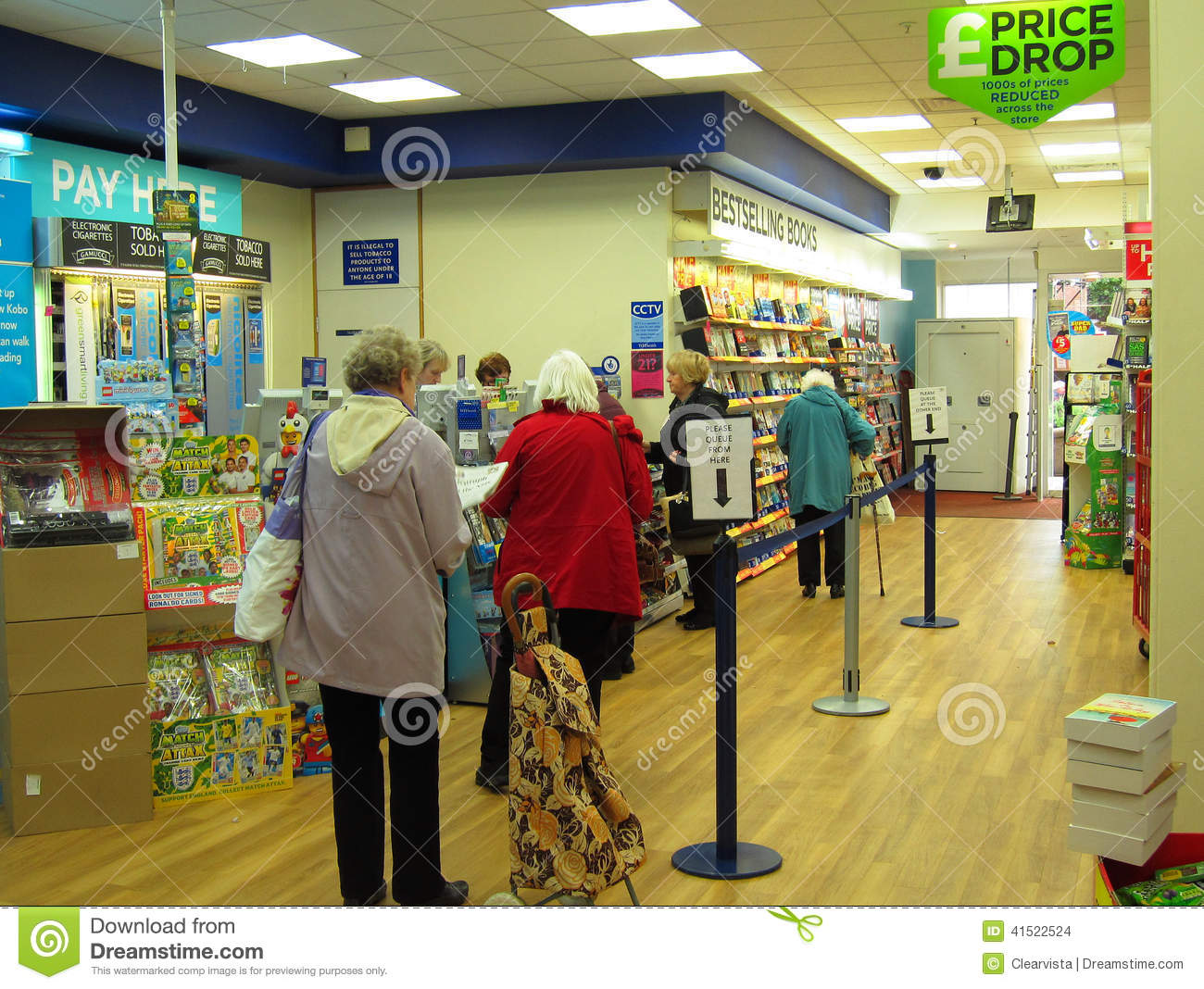 People queuing at a store checkout.