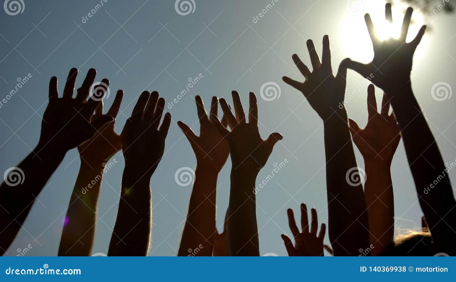 People raising hands, voting for democracy, volunteering campaign, leadership
