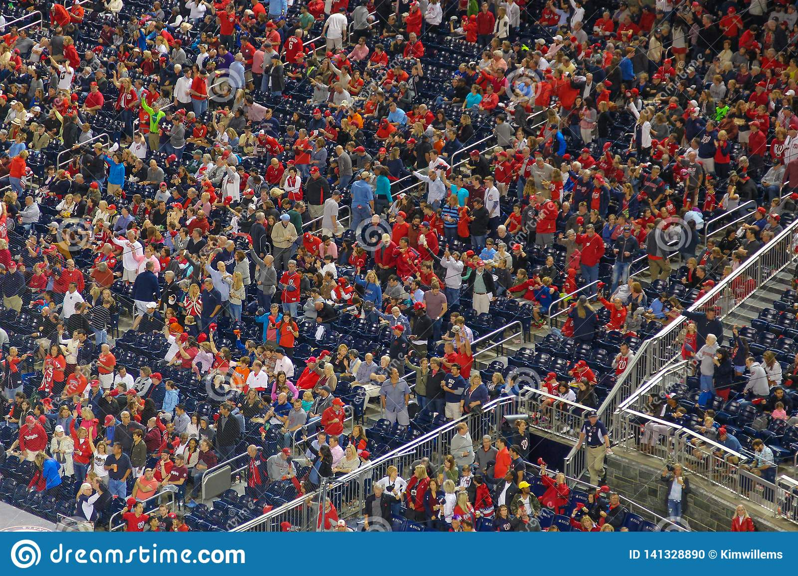 People in red cheering during an event