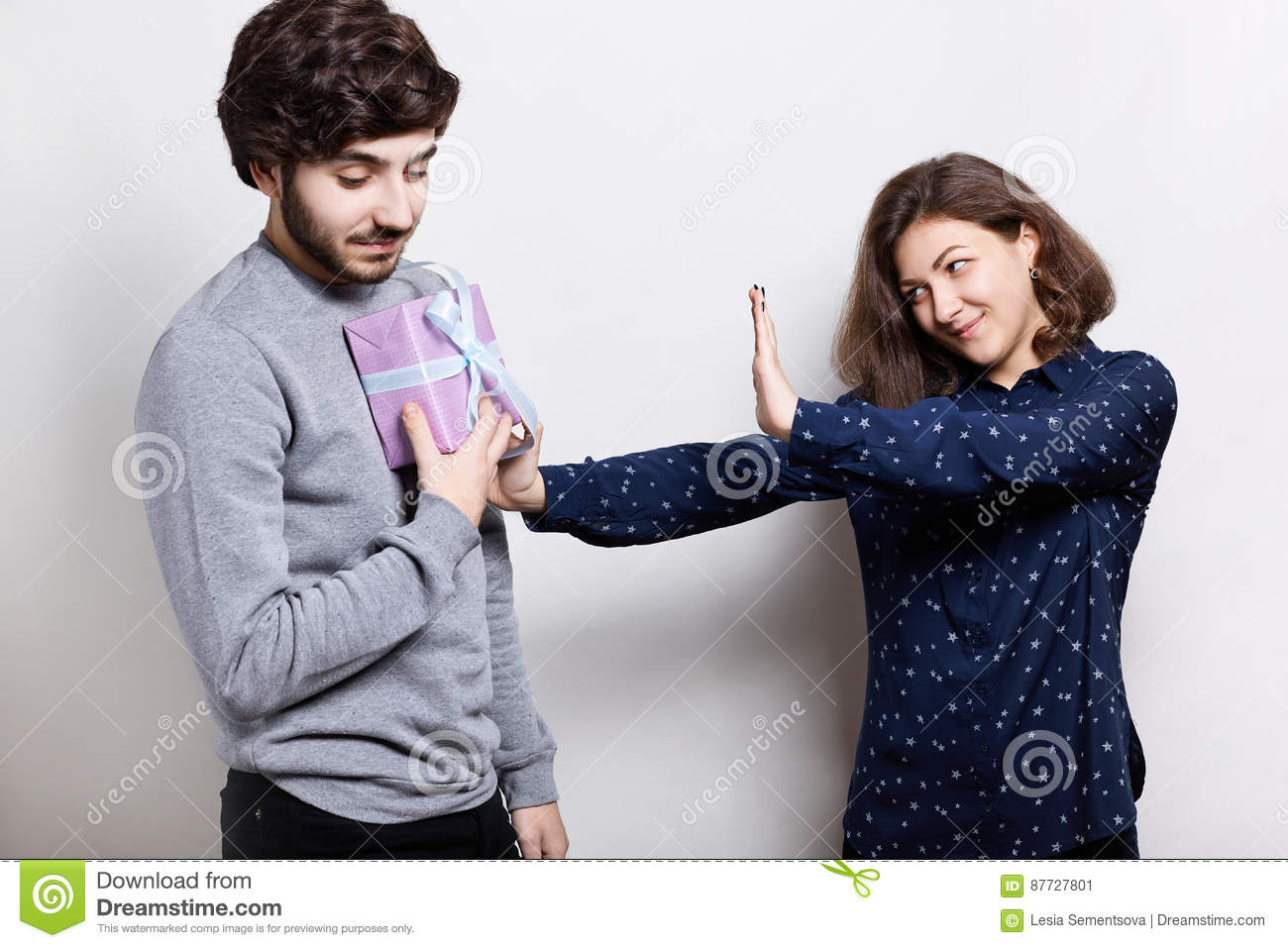 People And Relationships  Young Man Giving Offended Woman