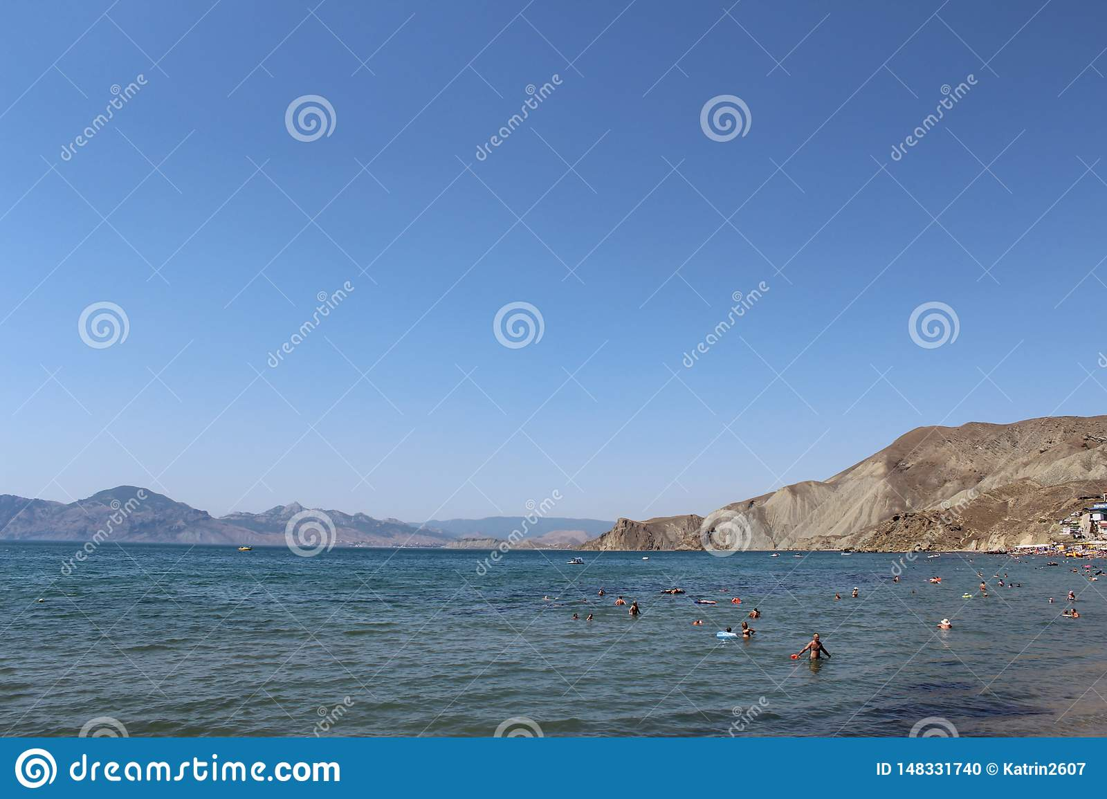 People relax on the sea in Crimea