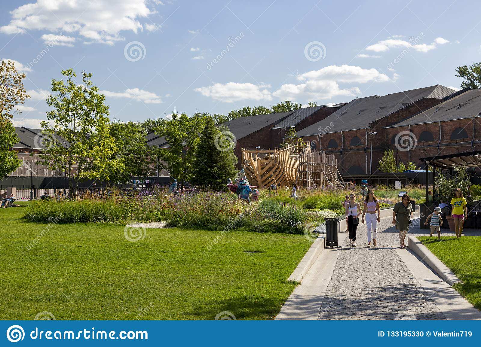 People relax on the territory of the city park `New Holland` in St. Petersburg