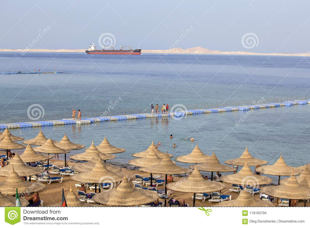 People rest on the beach near red sea in resort hotel, Sharm El Sheikh, Egypt