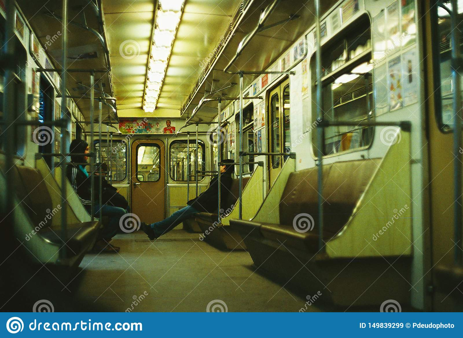 People ride the subway car