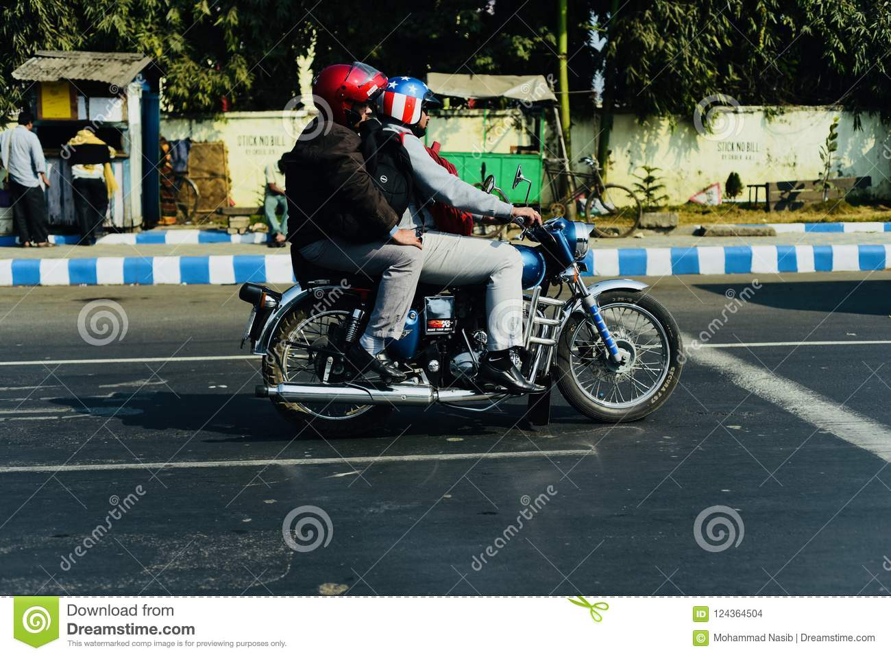 Download People Riding On A Bike On A Highway Wearing Helmets Unique Photo Editorial Stock Image - Image of helmets, streets: 124364504