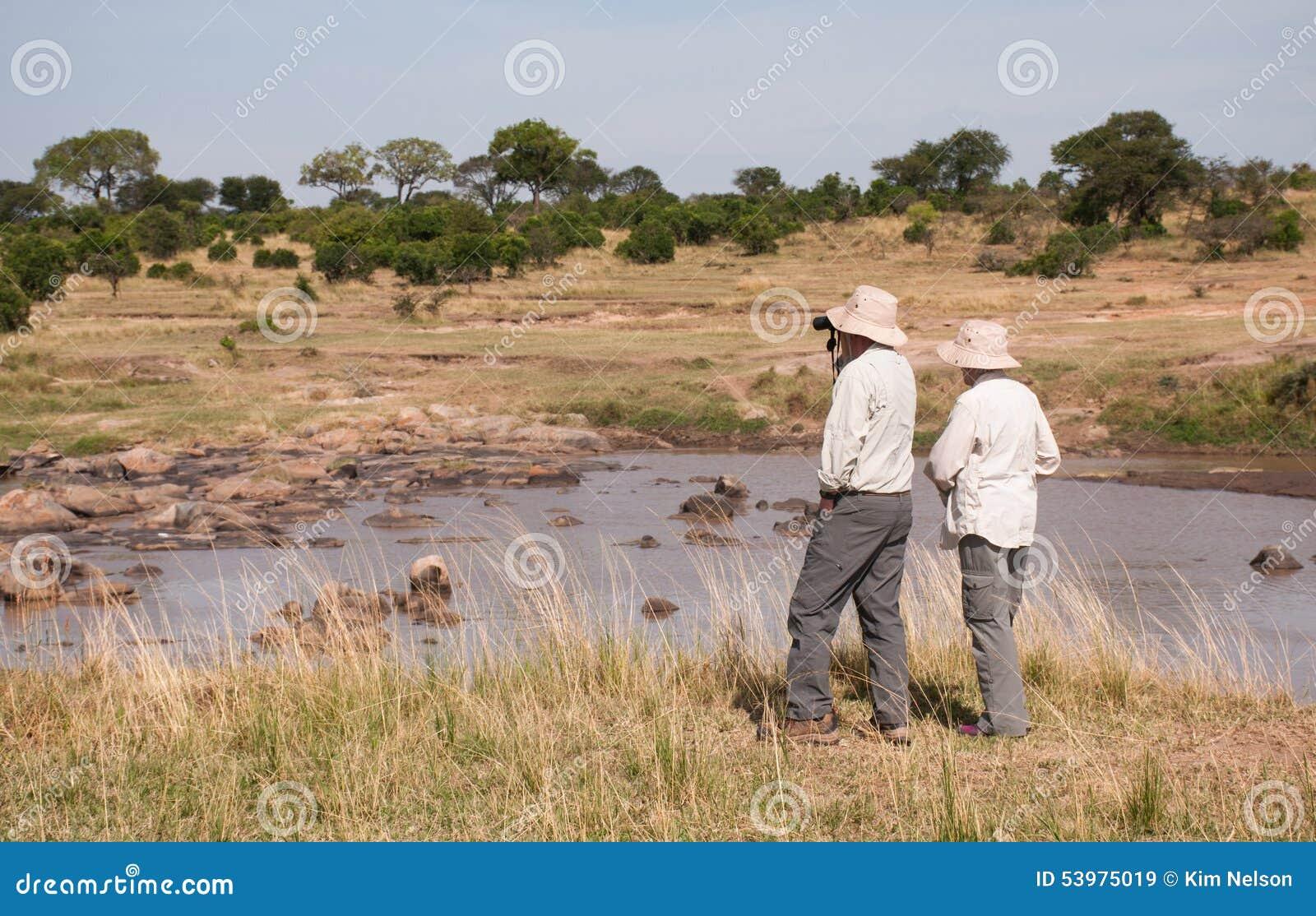 People On Safari In Tanzania, Mara River Stock Photo
