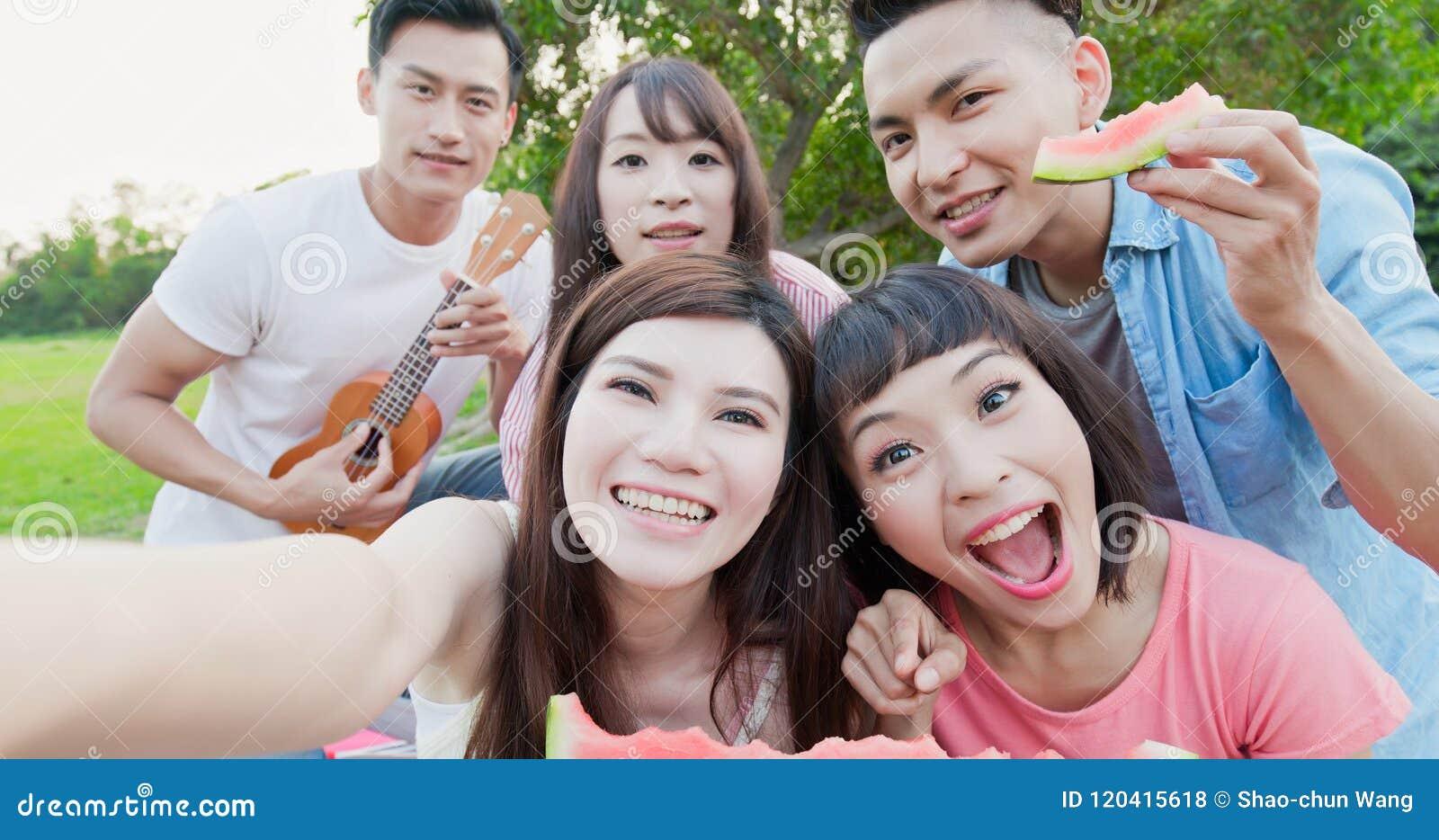 People enjoy at a picnic