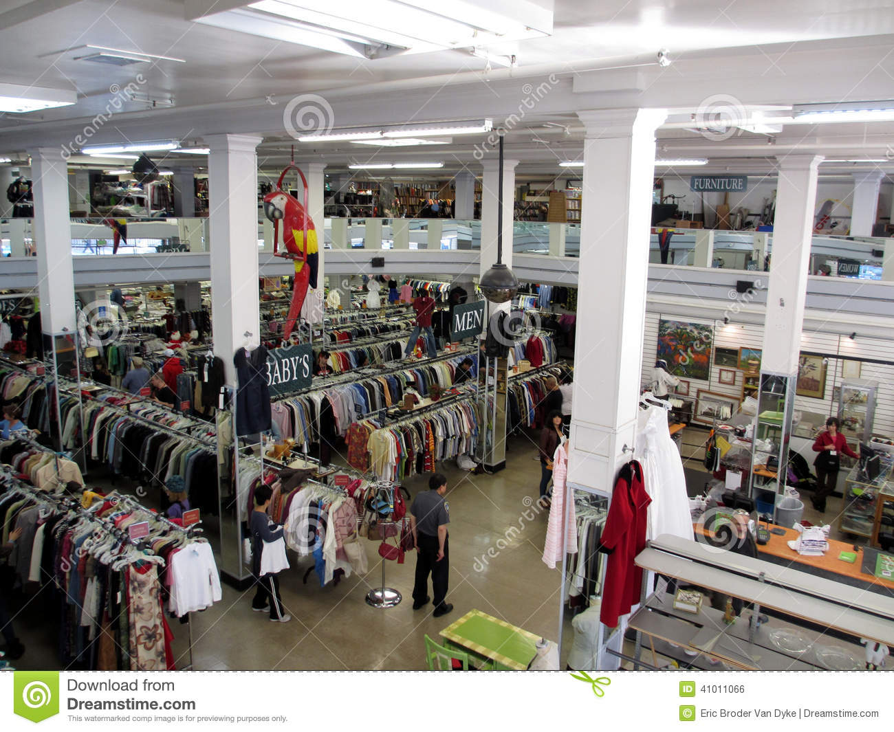 Editorial Photo: People shop for clothes inside a thrift store