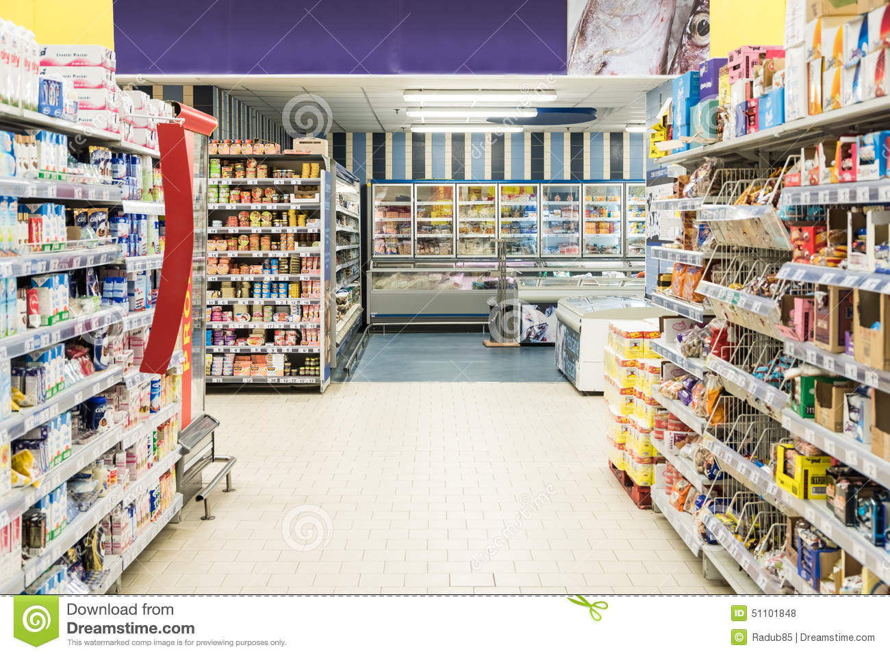 People Shopping In Supermarket Store Aisle