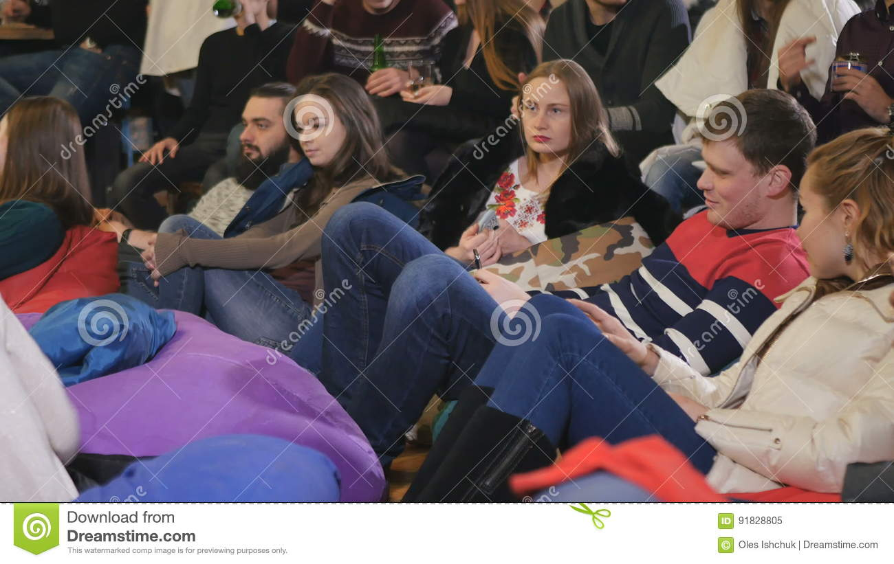 People Sit Down On The Pillow On The Floor And Watching Stand-up ...