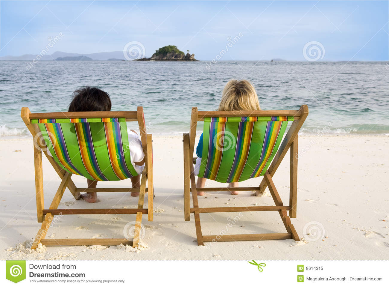 People Sitting Chairs At The Beach Royalty Free Stock Image