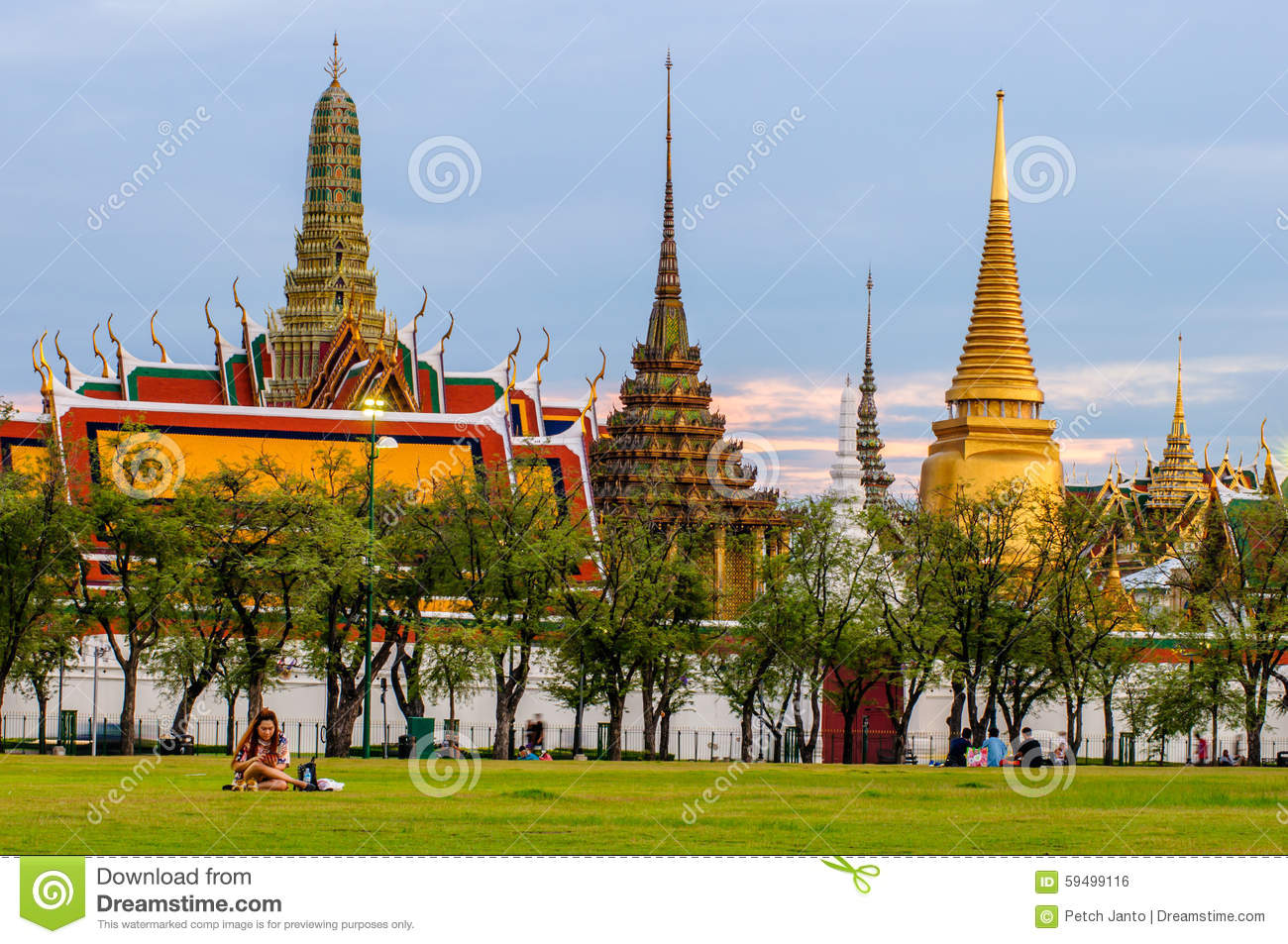 People Are Sitting In Sanam Luang In The Front Of Wat Phra Kaew And The Grand...