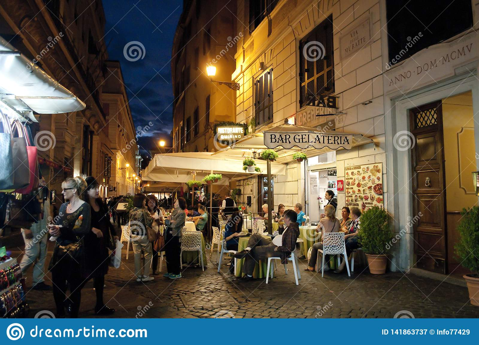 Street restaurants in Trevi district at night, Rome, Italy