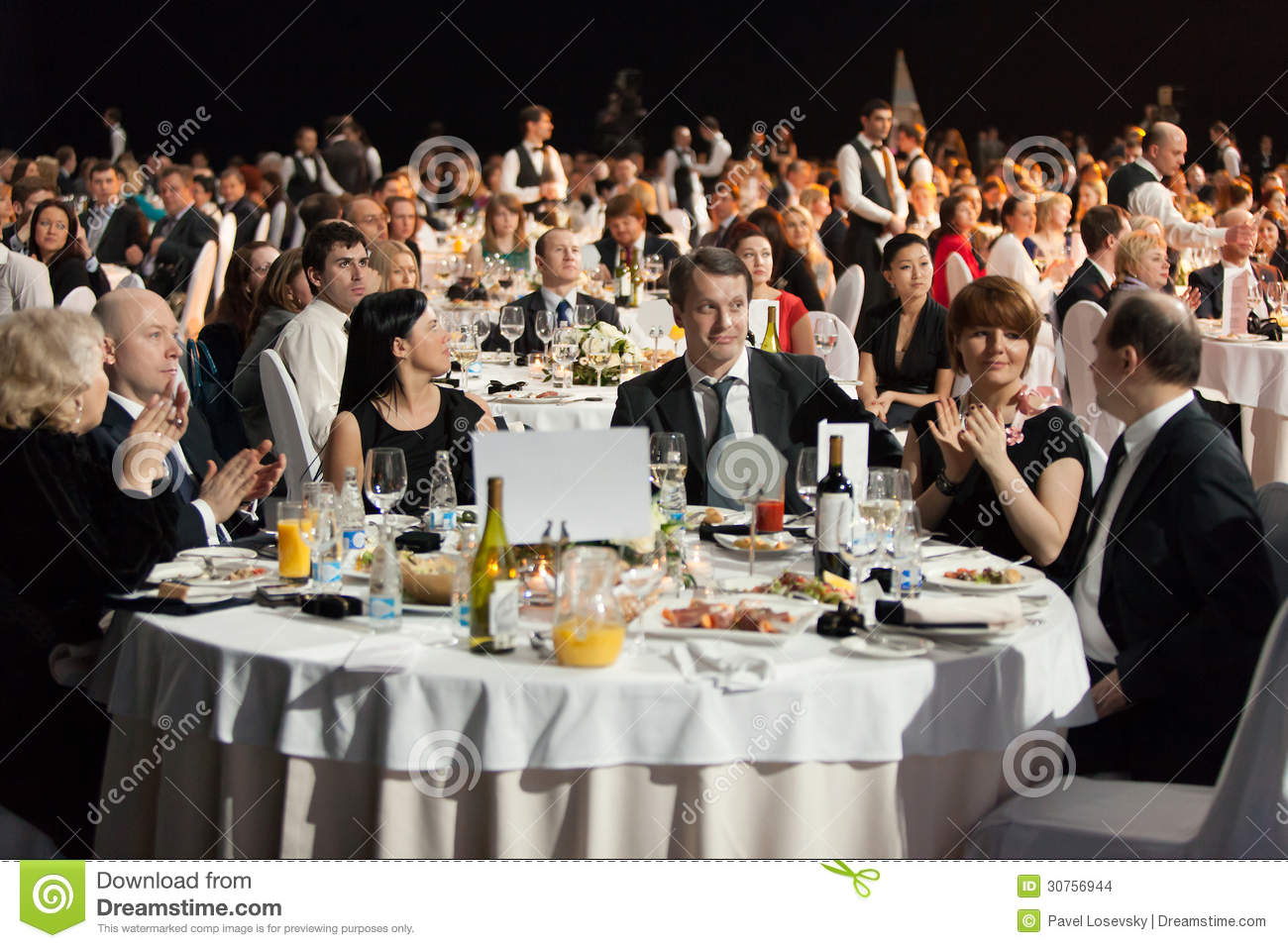 People Sitting At The Tables During Ceremony Of Rewarding