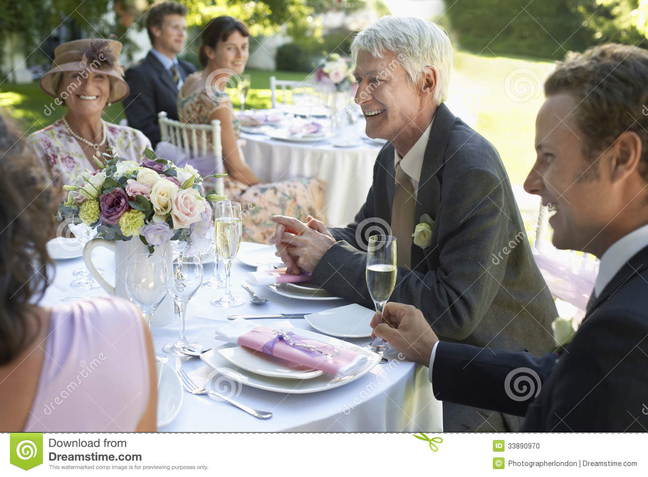 People Sitting At Wedding Tables Stock Photo