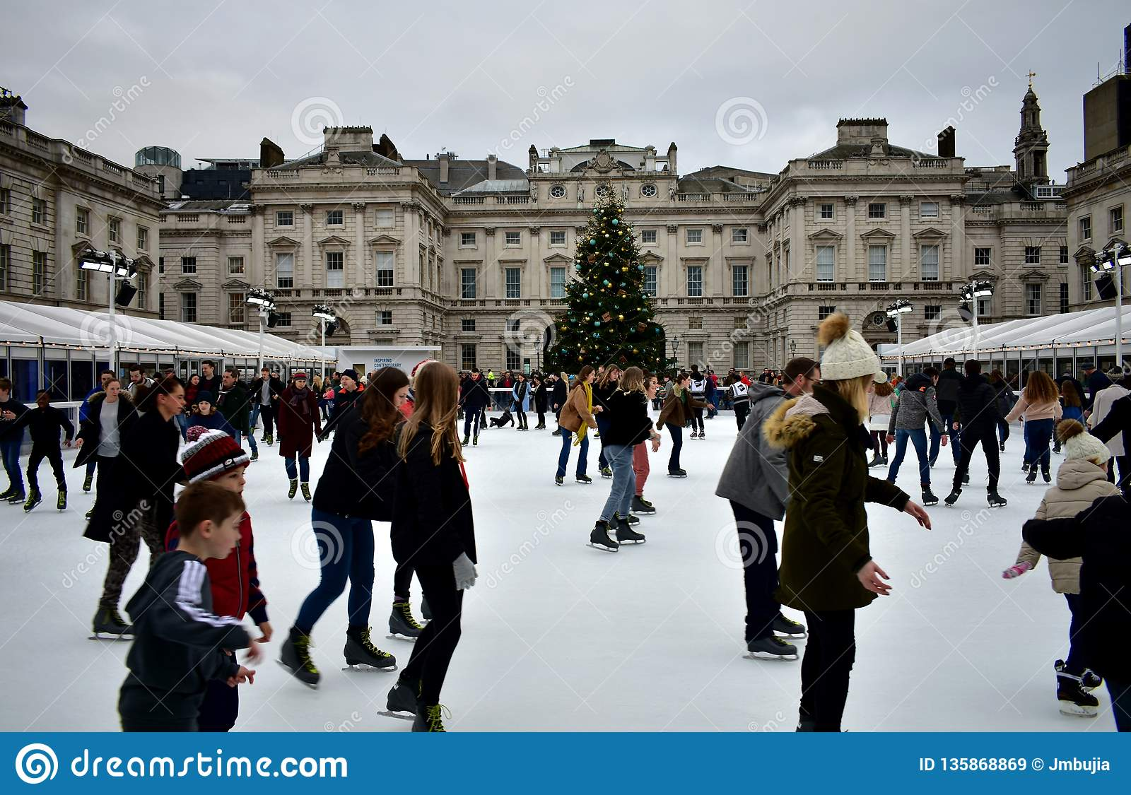 People skating on ice at the Somerset House Christmas Ice Rink. London, United Kingdom, December 2018.