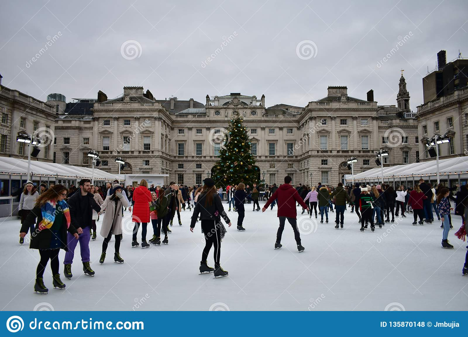 Christmas Ice Skating London.People Skating On Ice At The Somerset House Christmas Ice