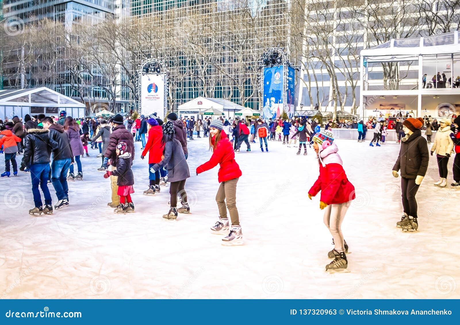 Christmas Village Ice Skating Rink.People At Skating Rink At Bryant Park On Christmas Downtown