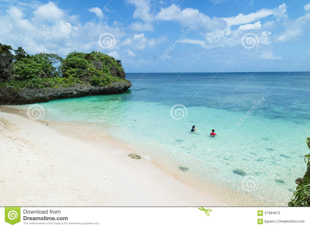 People Snorkeling In Clear Turquoise Water Of A Secluded Tropical Beach Okinawa Japan