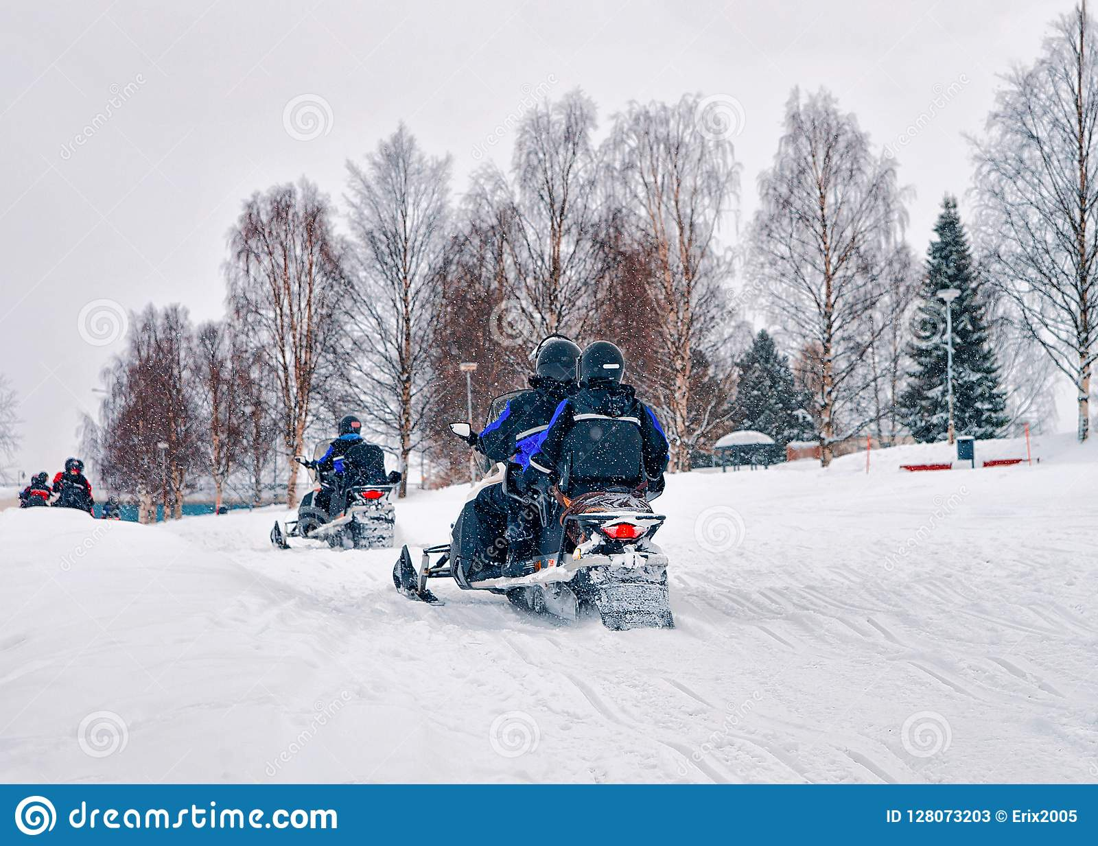 People on Snow mobiles Winter Finland Lapland during Christmas