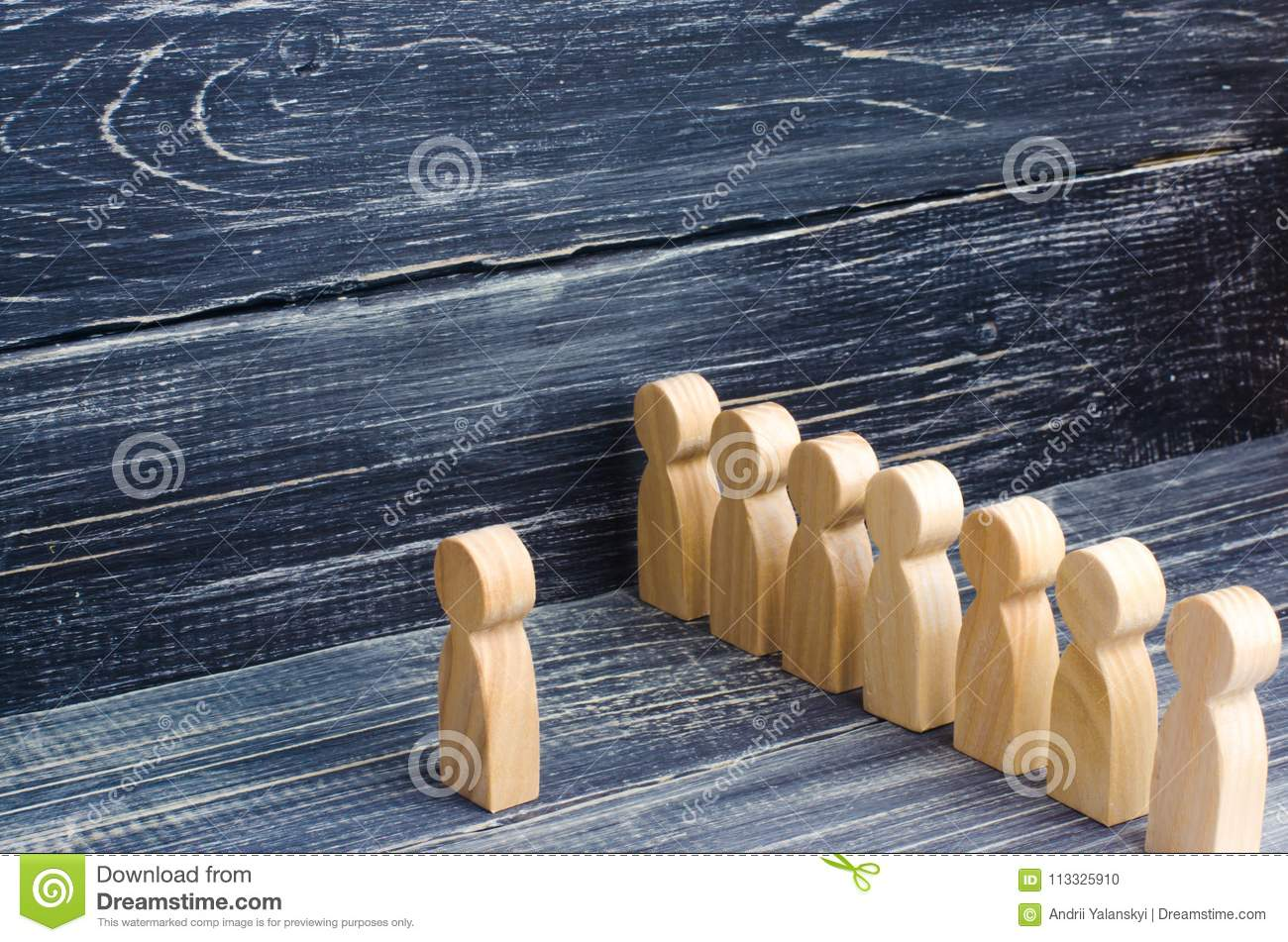 People stand in line at the briefing and wait for orders. Wooden figures of people are waiting in line. Concept of business, army,