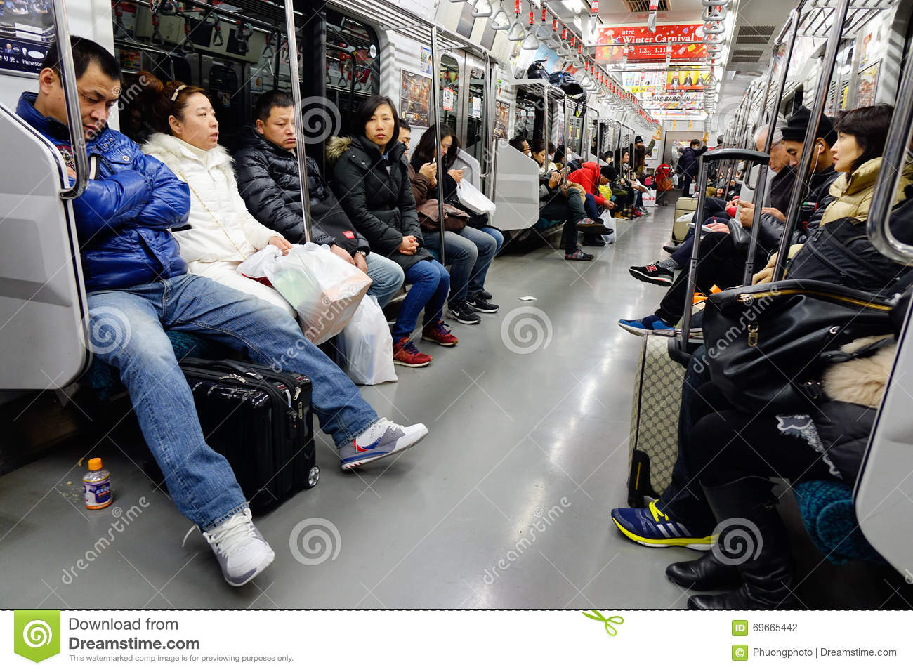 People In The Subway Train At Night In Osaka, Japan ...